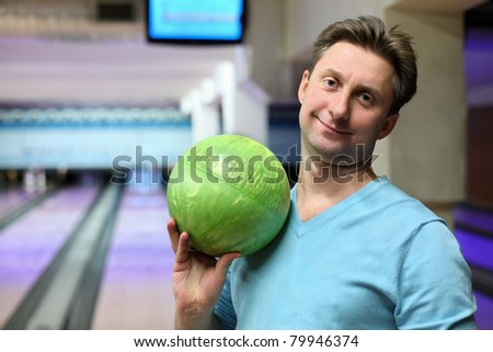 Portrait of man with ball for bowling - stock photo