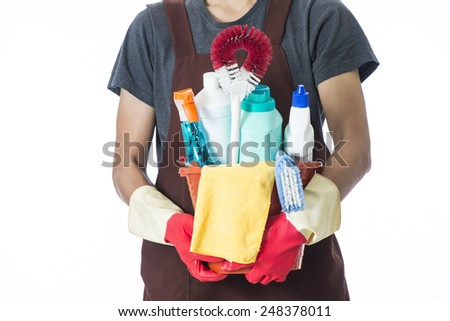 Portrait of man with cleaning equipment ready to clean house - stock photo