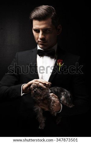Portrait of man with dog, godfather-like character.   - stock photo