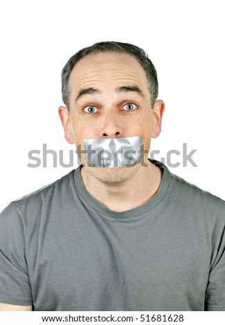 Portrait of man with duct tape over his mouth - stock photo