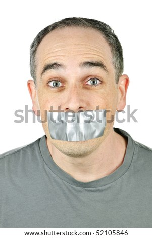 Portrait of man with duct tape over his mouth