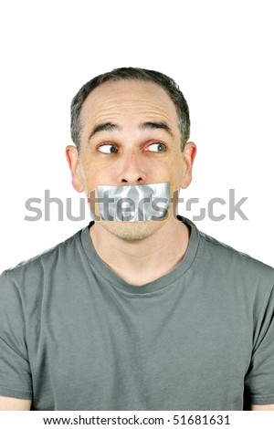 Portrait of man with duct tape over his mouth glancing sideways - stock photo