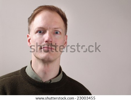Portrait of man with funny face - stock photo