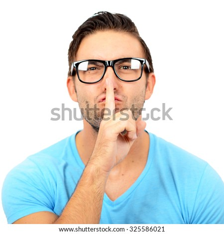 Portrait of man with gesture for silence against white background - stock photo