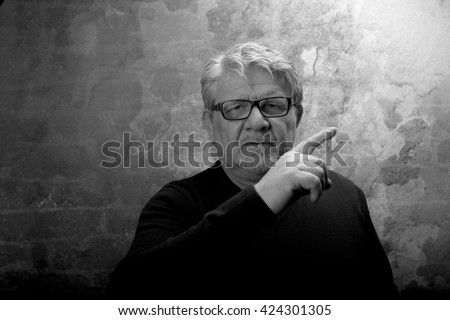 portrait of man with glasses. studio shot. Add film effect