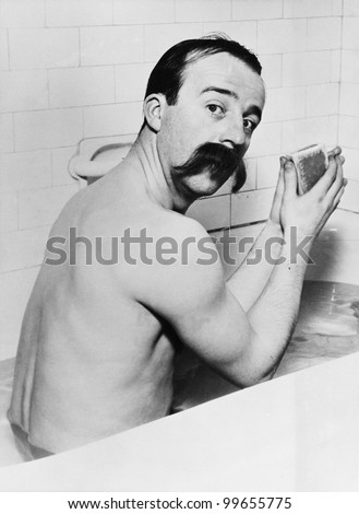 Portrait of man with huge mustache in bath - stock photo