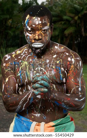 portrait of man with multicolored body paint on skin - stock photo