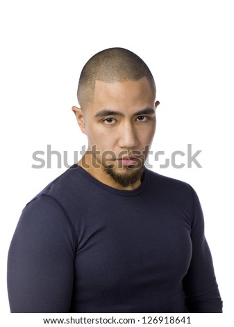 Portrait of man with serious look against white background - stock photo