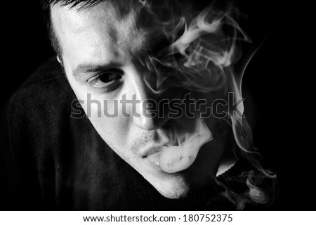 Portrait of man with smoke,low key and black and white techniques