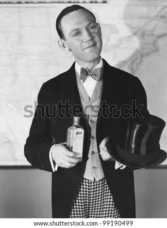 Portrait of man with top hat and bottle - stock photo