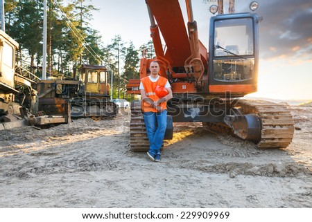 Portrait of man working in a helmet about Excavator - stock photo