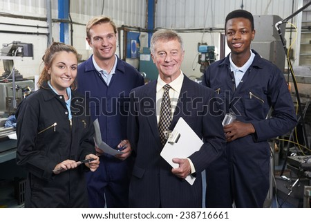 Portrait Of Manager And Staff In Engineering Factory - stock photo