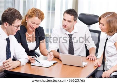 Portrait of manager man listening to his office workers. Red-haired lady trying to explain her view upon certain business projects during meeting in board room Hi Res.