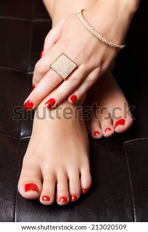Portrait of manicured nails and pedicured toes with nail polish - stock photo