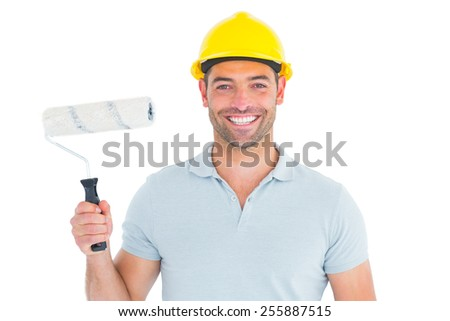 Portrait of manual worker holding paint roller on white background