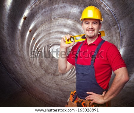 portrait of manual worker in concrete tunnel