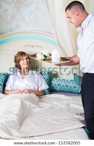 Portrait of married couple in apartments in a morning - stock photo