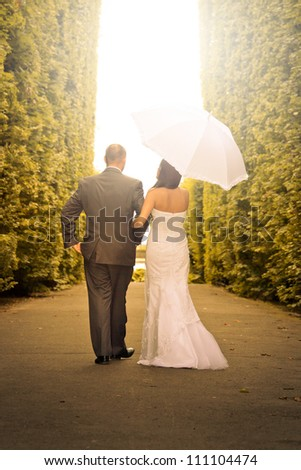 Portrait of married couple in green park scenery