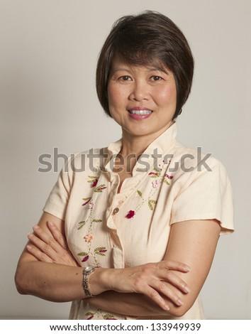 Portrait of mature Asian woman - stock photo