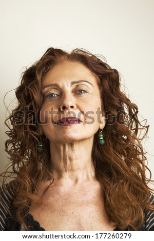 Portrait of mature attractive woman against white background - stock photo