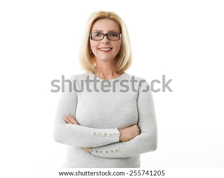 Portrait of mature business woman smile while standing against white background.