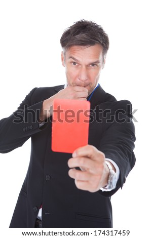 Portrait Of Mature Businessman Showing Red Card Over White Background - stock photo