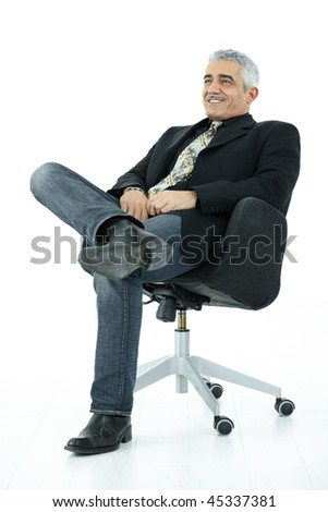 Portrait of mature businessman sitting in office chair in confident pose. Isolated on white. - stock photo