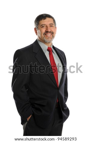 Portrait of mature businessman smiling with his hands in pockets - stock photo
