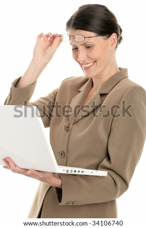 Portrait of mature businesswoman using laptop isolated on white background - stock photo