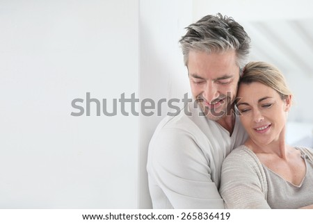 Portrait of mature couple embracing each other - stock photo