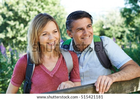 Portrait Of Mature Couple Hiking In Countryside
