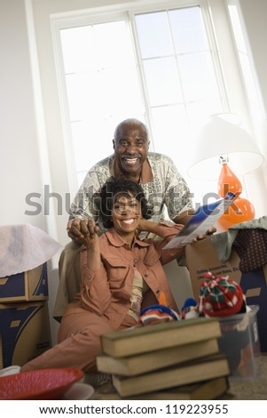 Portrait of mature couple in new apartment - stock photo