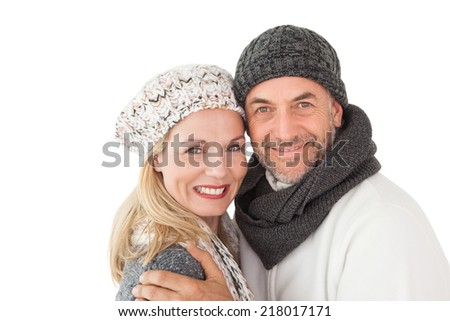 Portrait of mature couple in warm clothing over white background - stock photo