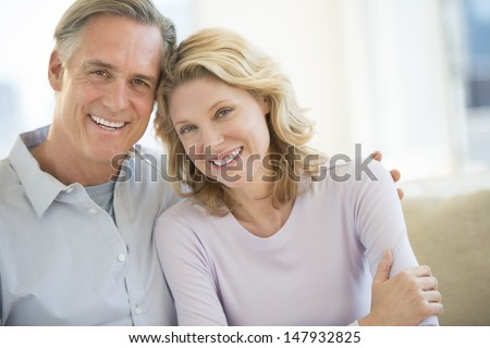 Portrait of mature couple smiling together at home - stock photo