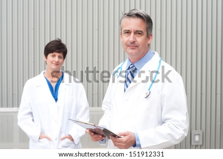 portrait of mature doctor at hospital