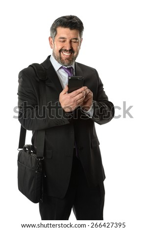 Portrait of mature Hispanic businessman using cellphone isolated over white background - Focus on phone - stock photo
