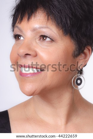 portrait of mature lady of polynesian ethnicity - stock photo