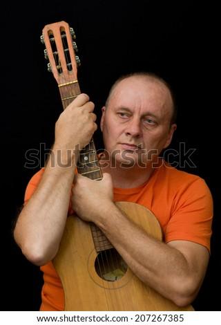Portrait of mature man - amateur guitarist - stock photo
