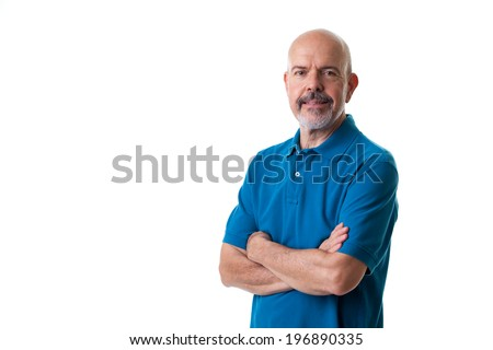 Portrait of mature man in blue polo shirt fold his arms isolated on white - stock photo
