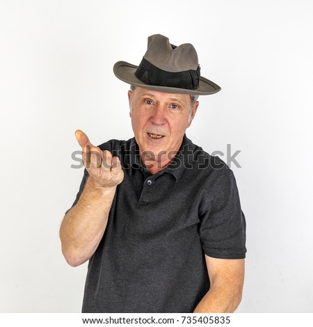 portrait  of  mature man in emotion with hat