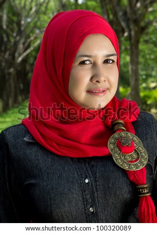 portrait of mature muslim woman on nature background