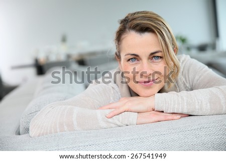 Portrait of mature smiling blond woman  - stock photo