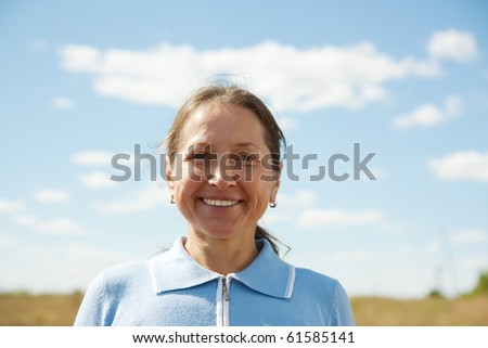 Portrait of mature woman against summer day