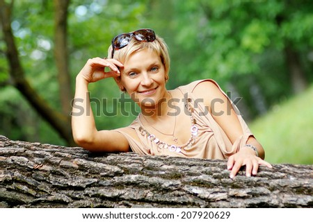 Portrait of mature woman in summer park