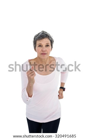 Portrait of mature woman jogging against white background - stock photo