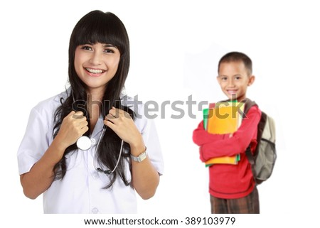 portrait of medical doctor with kid patient at the background - stock photo