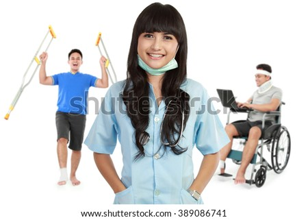 portrait of medical female doctor and patient using wheel chair and crutch at the background - stock photo
