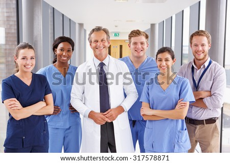 Portrait Of Medical Team Standing In Hospital Corridor - stock photo