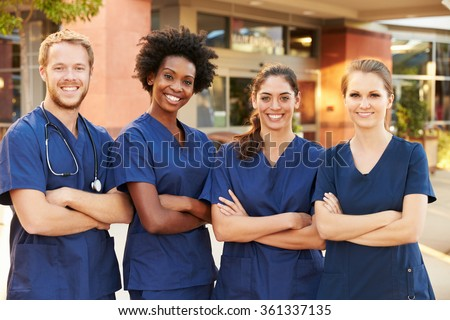 Portrait Of Medical Team Standing Outside Hospital - stock photo