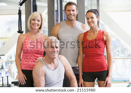 Portrait Of Men And Women At The Gym - stock photo